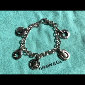 TIFFANY & CO. STERLING SILVER FIVE CHARM BRACELET